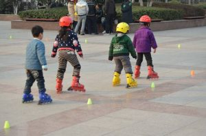 Young children learning to skate