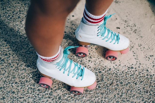 White roller skates with blue laces