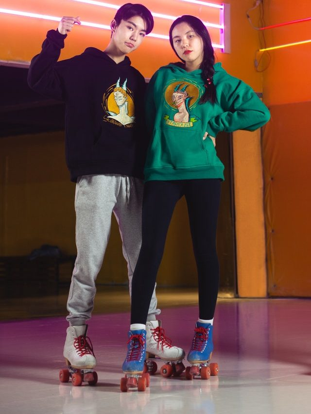 Couple standing in roller skates
