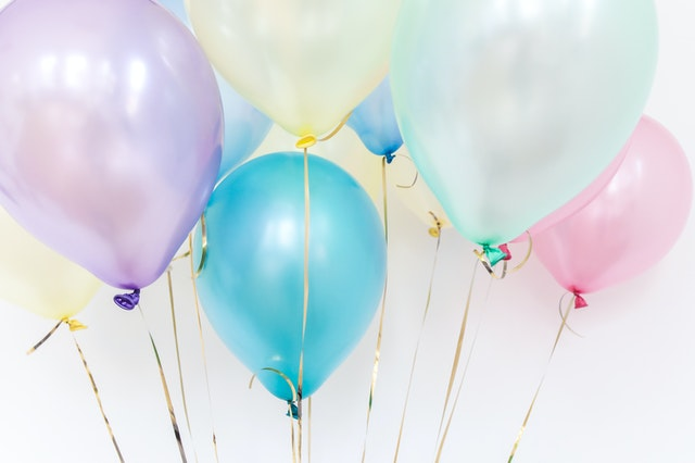 Close up photo of colorful pastel balloons